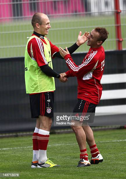 Arjen Robben and Rafinha joke around during an FC Bayern Muenchen training session at training ground Saebener Strasse on May 3 2012 in Munich Germany