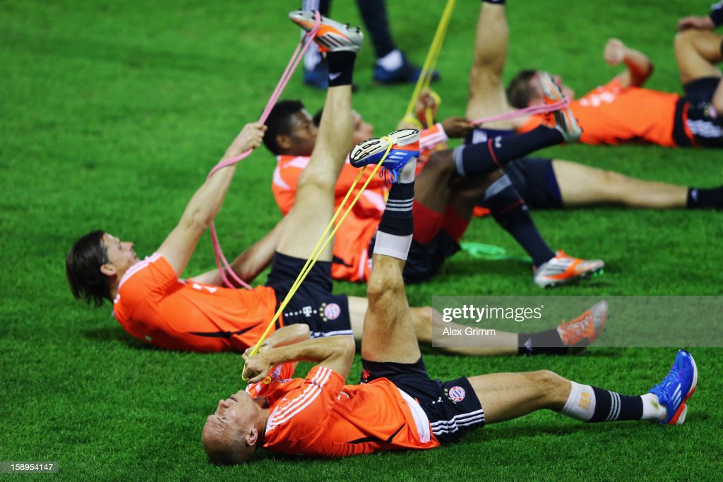 Arjen Robben (front) and team mates exercise during a Bayern Muenchen training session at the ASPIRE Academy for Sports Excellence on January 4, 2013 in Doha, Qatar.