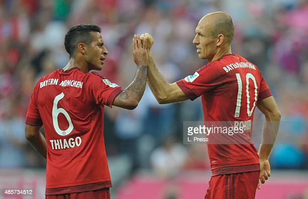 Arjen Robben and Thiago Alcantara of FC Bayern Muenchen celebrate scoring their team's third goal during the Bundesliga match between FC Bayern...