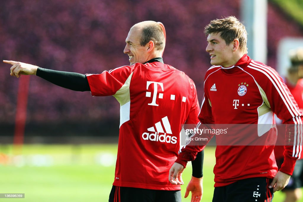 Arjen Robben (L) and Toni Kroos react during a training session of Bayern Muenchen at the ASPIRE Academy for Sports Excellence on January 4, 2012 in Doha, Qatar.