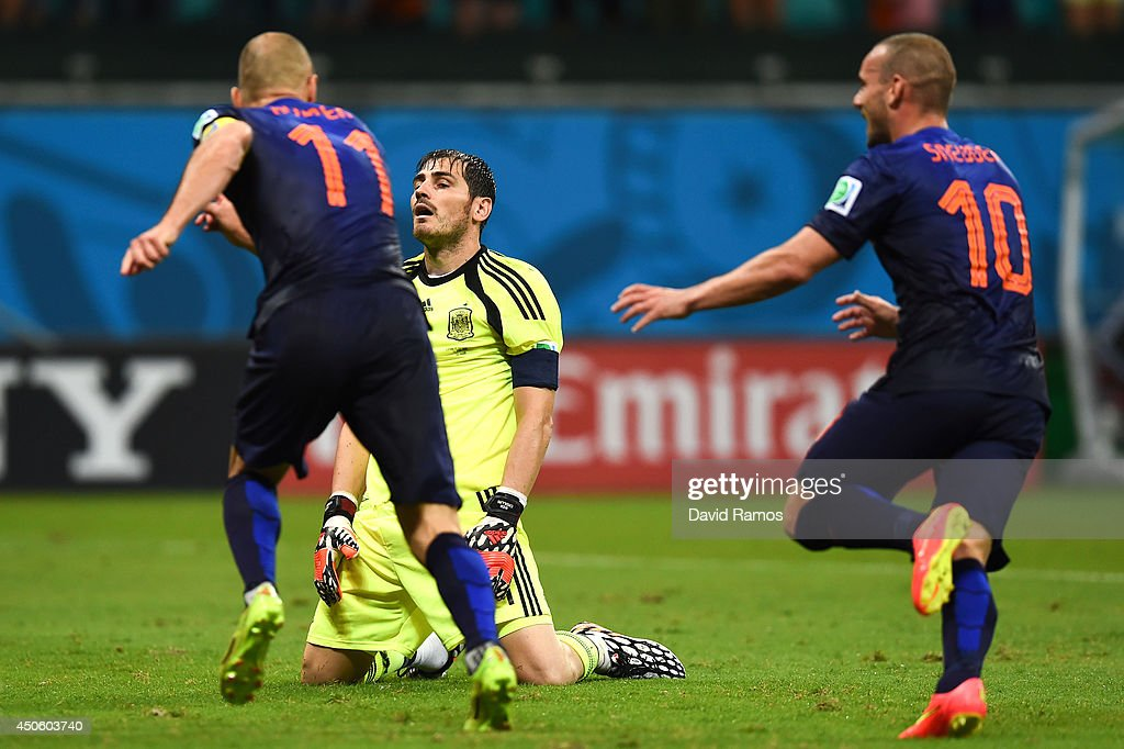 Arjen Robben andn Wesley Sneijder of Netherlands celebrate as Iker Casillas of Spain looks dejected after the Netherlands second goal during the 2014...