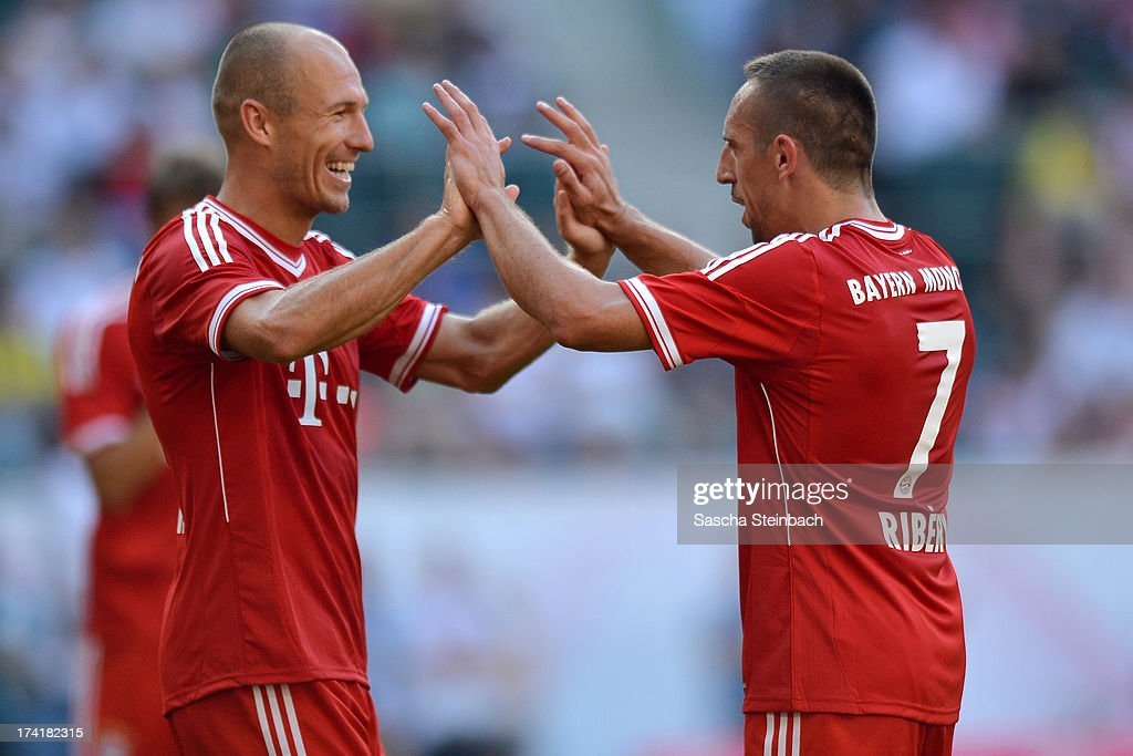 Arjen Robben (L) celebrates his team's 4th goal with Franck Ribery (R) of Muenchen during the Telekom Cup 2013 final match between Borussia Moenchengladbach and FC Bayern Muenchen at Borussia-Park on July 21, 2013 in Moenchengladbach, Germany.