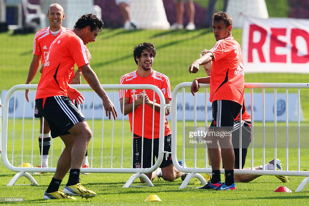 Arjen Robben, Claudio Pizarro, Javier Martinez and Rafinha (L-R) discuss during a Bayern Muenchen training session at the ASPIRE Academy for Sports Excellence on January 6, 2013 in Doha, Qatar.