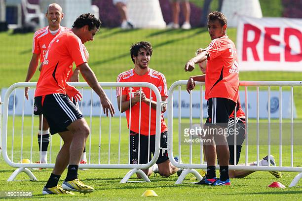 Arjen Robben Claudio Pizarro Javier Martinez and Rafinha discuss during a Bayern Muenchen training session at the ASPIRE Academy for Sports...