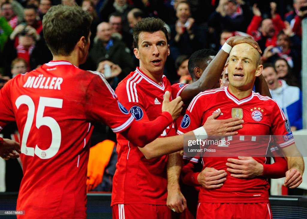 Arjen Robben (R-L), David Alaba, Mario Mandzukic and Thomas Mueller of Muenchen celebrate their third goal during the UEFA Champions League quarter-final second leg match between FC Bayern Muenchen and Manchester United at Allianz Arena on April 9, 2014 in Munich, Germany.