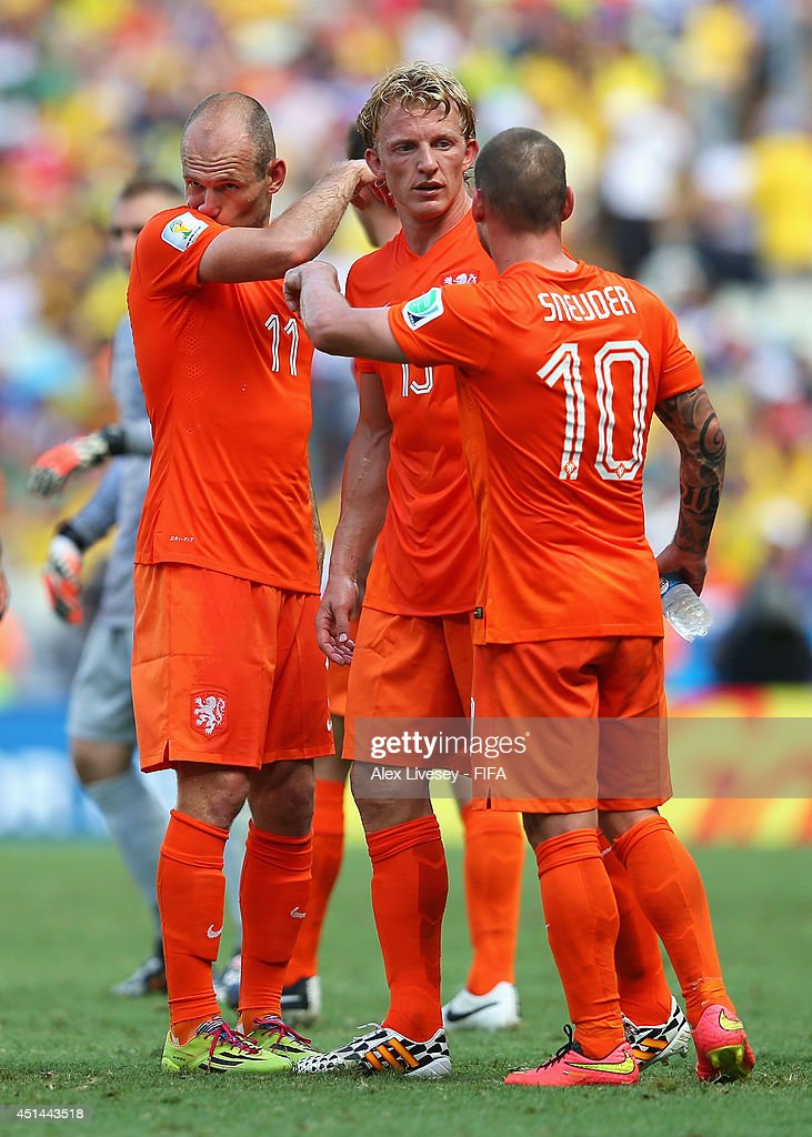 Arjen Robben Dirk Kuyt and Wesley Sneijder of the Netherlands discuss at a cooling break during the 2014 FIFA World Cup Brazil Round of 16 match...