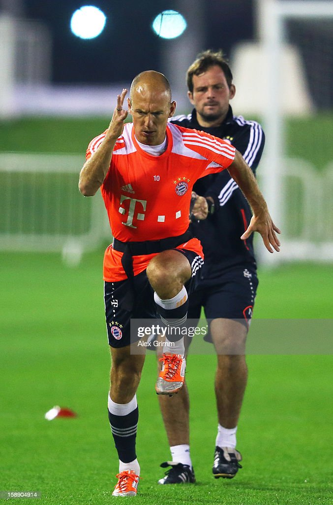 <a gi-track='captionPersonalityLinkClicked' href=/galleries/search?phrase=Arjen+Robben&family=editorial&specificpeople=194740 ng-click='$event.stopPropagation()'>Arjen Robben</a> exercises during a Bayern Muenchen training session at the ASPIRE Academy for Sports Excellence on January 3, 2013 in Doha, Qatar.