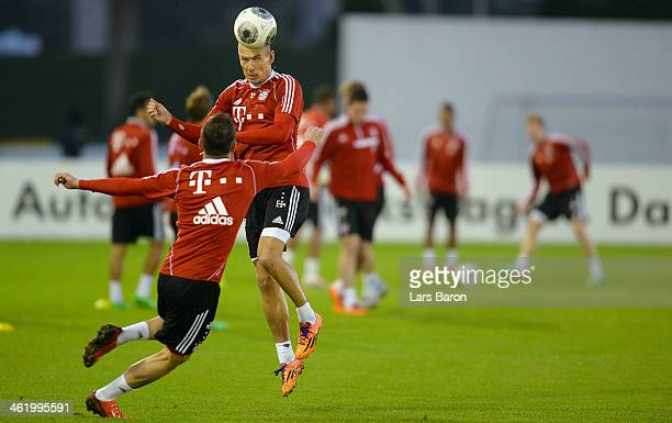Arjen Robben goes up for a header during a training session at day 8 of the Bayern Muenchen training camp at ASPIRE Academy for Sports Excellence on...