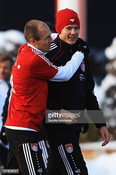 Arjen Robben hugs Holger Badstuber during the Bayern Muenchen training session at Bayern's training ground Saebener Strasse on December 16 2010 in...
