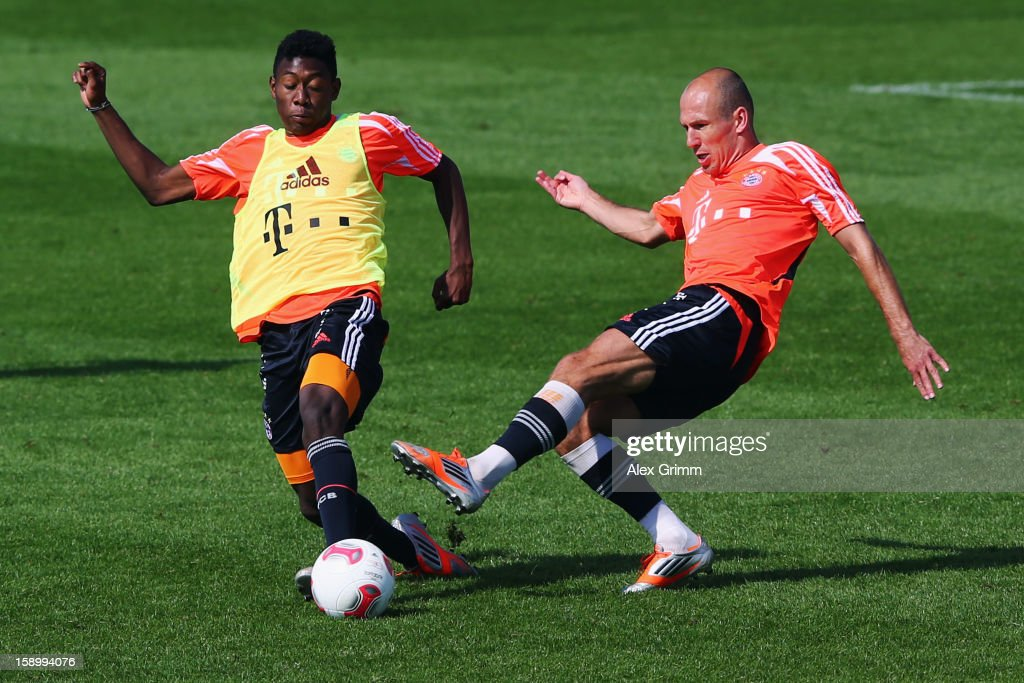 <a gi-track='captionPersonalityLinkClicked' href=/galleries/search?phrase=Arjen+Robben&family=editorial&specificpeople=194740 ng-click='$event.stopPropagation()'>Arjen Robben</a> (R) is challenged by <a gi-track='captionPersonalityLinkClicked' href=/galleries/search?phrase=David+Alaba&family=editorial&specificpeople=5494608 ng-click='$event.stopPropagation()'>David Alaba</a> during a Bayern Muenchen training session at the ASPIRE Academy for Sports Excellence on January 5, 2013 in Doha, Qatar.