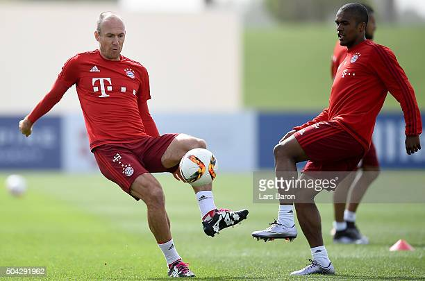 Arjen Robben is challenged by Douglas Costa during a training session at day five of the Bayern Muenchen training camp at Aspire Academy on January...