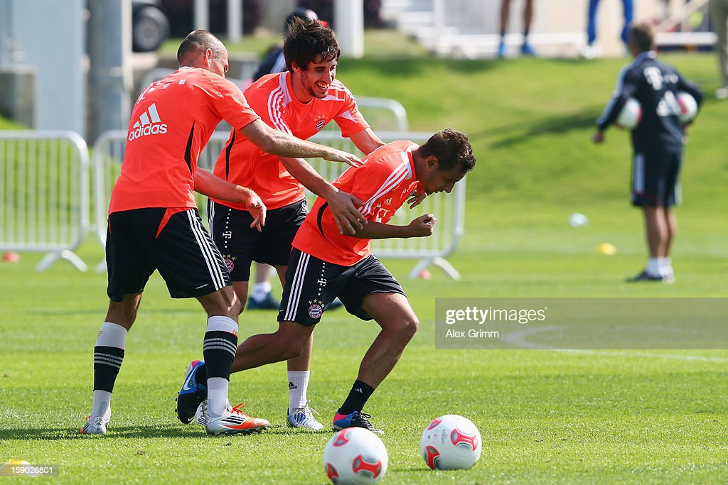 Arjen Robben, Javier Martinez and Rafinha fight during a Bayern Muenchen training session at the ASPIRE Academy for Sports Excellence on January 6, 2013 in Doha, Qatar.