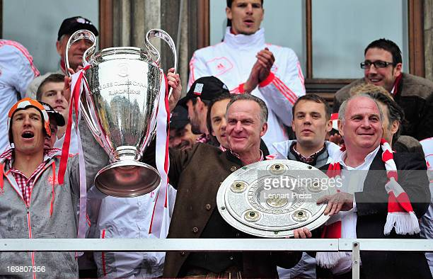 Arjen Robben KarlHeinz Rummenigge CEO of FC Bayern Muenchen and Uli Hoeness president of Bayern Muenchen celebrate winning the Bundesliga Champions...