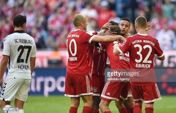 Arjen Robben Kingsley Coman Thomas Mueller Thiago and Joshua Kimmich of FC Bayern Munich celebrate after scoring a goal during the Bundesliga soccer...