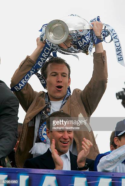Arjen Robben lifts the Premiership trophy above the head of Owner Roman Abramovich during the FA Barclays Premiership Champions Parade held along the...