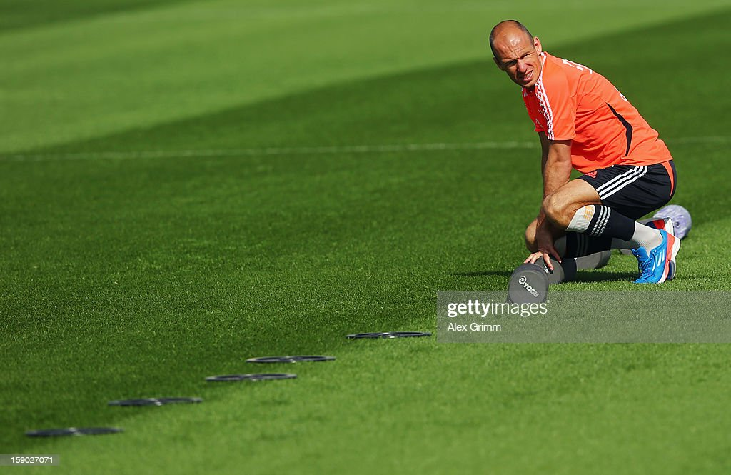 <a gi-track='captionPersonalityLinkClicked' href=/galleries/search?phrase=Arjen+Robben&family=editorial&specificpeople=194740 ng-click='$event.stopPropagation()'>Arjen Robben</a> looks on prior to a Bayern Muenchen training session at the ASPIRE Academy for Sports Excellence on January 6, 2013 in Doha, Qatar.
