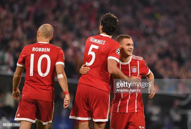 Arjen Robben Mats Hummels and Joshua Kimmich of Bayern Munich celebrate during the UEFA the Champions League group B soccer match between FC Bayern...