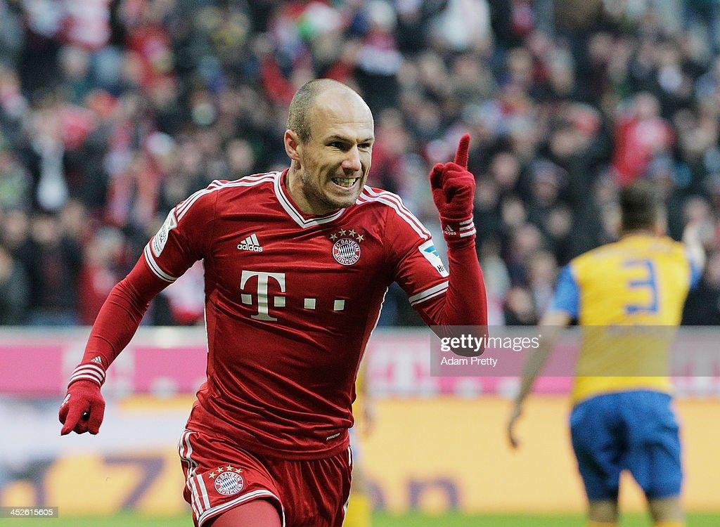 Arjen Robben of Bayern celebrates after heading in a goal during the Bundesliga match between Bayern Muenchen and Eintracht Braunschweig at Allianz...