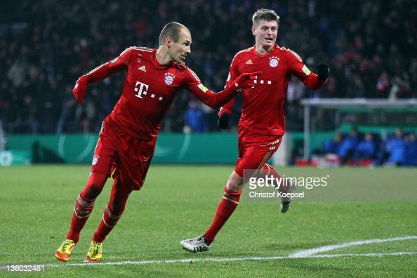 Arjen Robben of Bayern celebrates the second goal with Toni Kroos of Bayern during the DFB Cup round of sixteen match between VfL Bochum and FC...