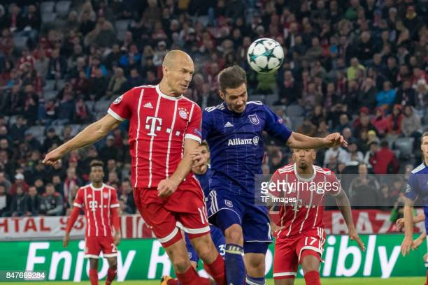 Arjen Robben of Bayern Muenchen and Alexandru Chipciu of RSC Anderlecht battle for the ball during the UEFA Champions League group B match between...