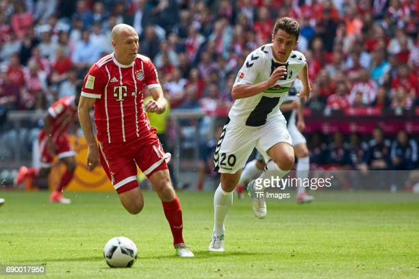 Arjen Robben of Bayern Muenchen and MarcOliver Kempf of Freiburg battle for the ball during the Bundesliga match between Bayern Muenchen and SC...