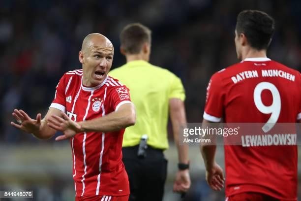 Arjen Robben of Bayern Muenchen argues with Robert Lewandowski of Bayern Muenchen during the Bundesliga match between TSG 1899 Hoffenheim and FC...
