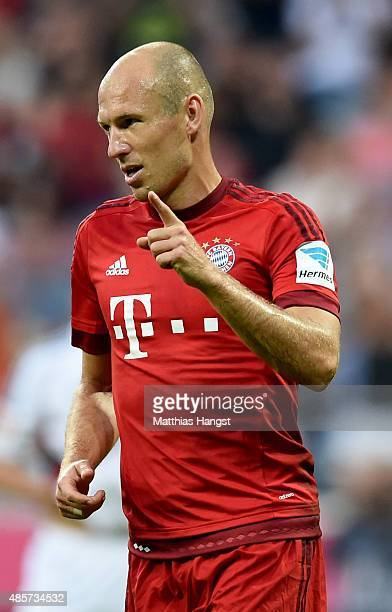 Arjen Robben of Bayern Muenchen celebrates after he scores the 3rd goal by penalty during the Bundesliga match between FC Bayern Muenchen and Bayer...