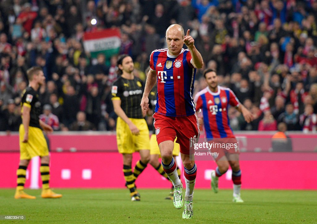 <a gi-track='captionPersonalityLinkClicked' href=/galleries/search?phrase=Arjen+Robben&family=editorial&specificpeople=194740 ng-click='$event.stopPropagation()'>Arjen Robben</a> of Bayern Muenchen celebrates after scoring their second goal from the penalty spot during the Bundesliga match between FC Bayern Muenchen and Borussia Dortmund at Allianz Arena on November 1, 2014 in Munich, Germany.