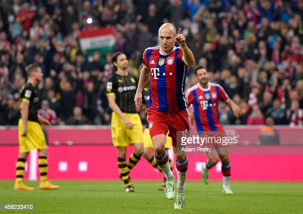 Arjen Robben of Bayern Muenchen celebrates after scoring their second goal from the penalty spot during the Bundesliga match between FC Bayern...