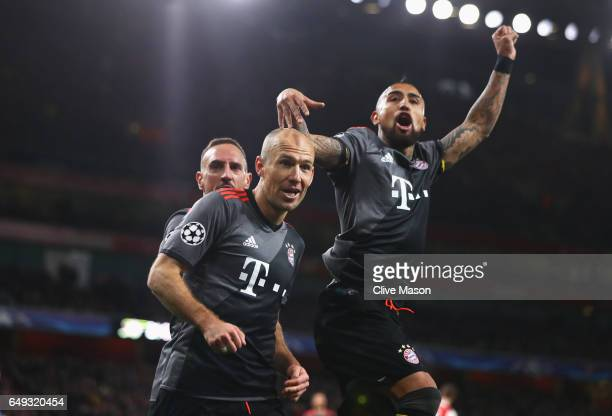Arjen Robben of Bayern Muenchen celebrates as he scores their second goal with team mates Arturo Vidal and Franck Ribery during the UEFA Champions...