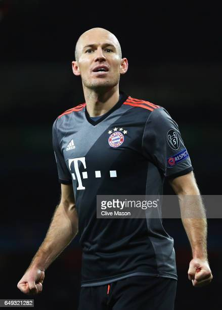 Arjen Robben of Bayern Muenchen celebrates as he scores their second goal during the UEFA Champions League Round of 16 second leg match between...