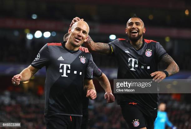 Arjen Robben of Bayern Muenchen celebrates as he scores their second goal with team mate Arturo Vidal during the UEFA Champions League Round of 16...