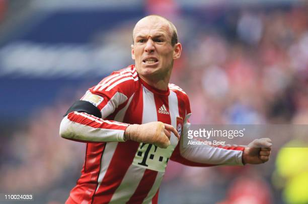 Arjen Robben of Bayern Muenchen celebrates his first goal during the Bundesliga match between 1 FC Muenchen and Hamburger SV at Allianz Arena on...