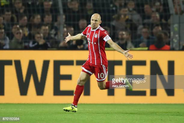 Arjen Robben of Bayern Muenchen celebrates his goal to make it 01 during the Bundesliga match between Borussia Dortmund and FC Bayern Muenchen at...
