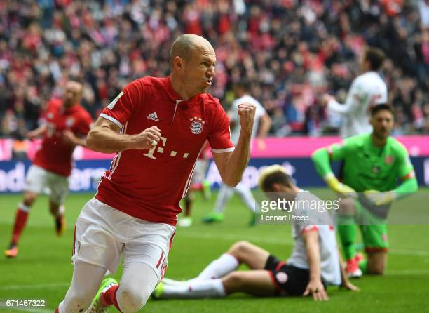 Arjen Robben of Bayern Muenchen celebrates scoring his side's first goal during the Bundesliga match between Bayern Muenchen and 1 FSV Mainz 05 at...