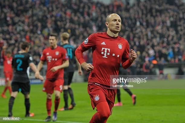Arjen Robben of Bayern Muenchen celebrates scoring his side's fourth goal during the UEFA Champions League Group F match between FC Bayern Muenchen...