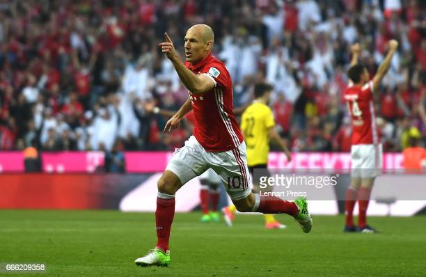 Arjen Robben of Bayern Muenchen celebrates scoring his sides third goal during the Bundesliga match between Bayern Muenchen and Borussia Dortmund at...