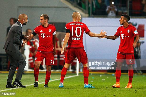 Arjen Robben of Bayern Muenchen celebrates scoring his teams first goal of the game with team mates and Pep Guardiola during the DFL Supercup match...