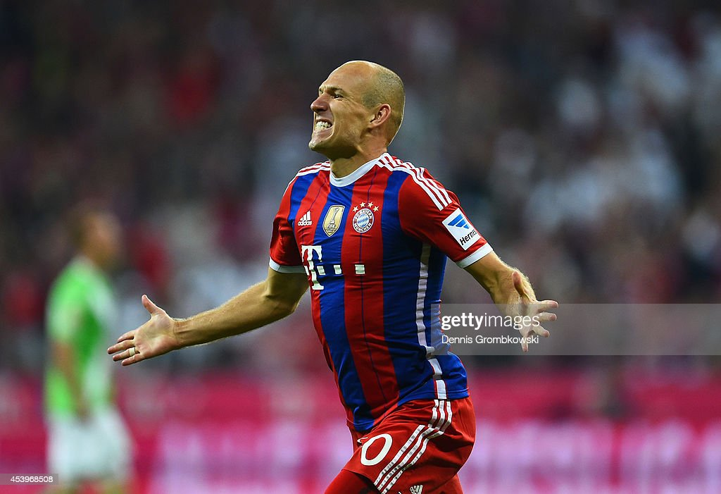 Arjen Robben of Bayern Muenchen celebrates scoring the second goal during the Bundesliga match between FC Bayern Muenchen and VfL Wolfsburg at...
