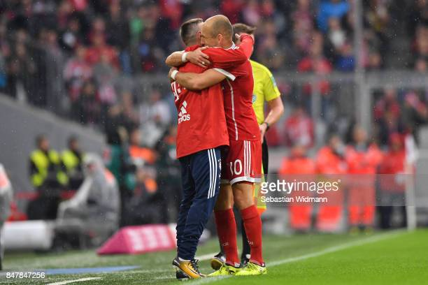 Arjen Robben of Bayern Muenchen celebrates with Franck Ribery of Bayern Muenchen after he scored his teams second goal to make it 20 during the...