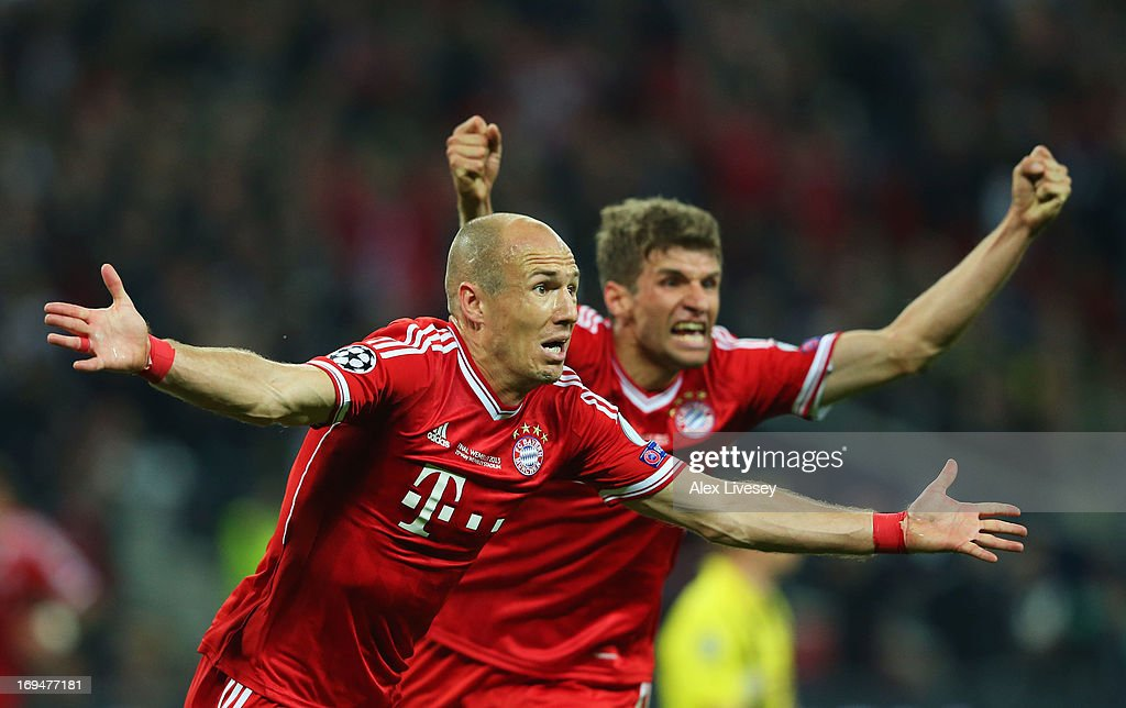 Arjen Robben of Bayern Muenchen celebrates with teammate Thomas Mueller after scoring a goal during the UEFA Champions League final match between...