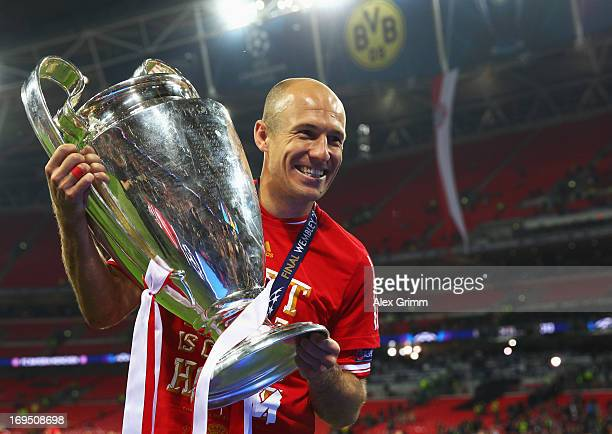 Arjen Robben of Bayern Muenchen celebrates with the trophy after victory in the UEFA Champions League final match between Borussia Dortmund and FC...