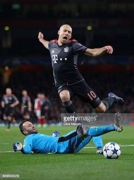 Arjen Robben of Bayern Muenchen evades goalkeeper David Ospina of Arsenal during the UEFA Champions League Round of 16 second leg match between...