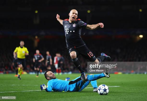 Arjen Robben of Bayern Muenchen evades goalkeeper David Ospina of Arsenal to score their second goal during the UEFA Champions League Round of 16...