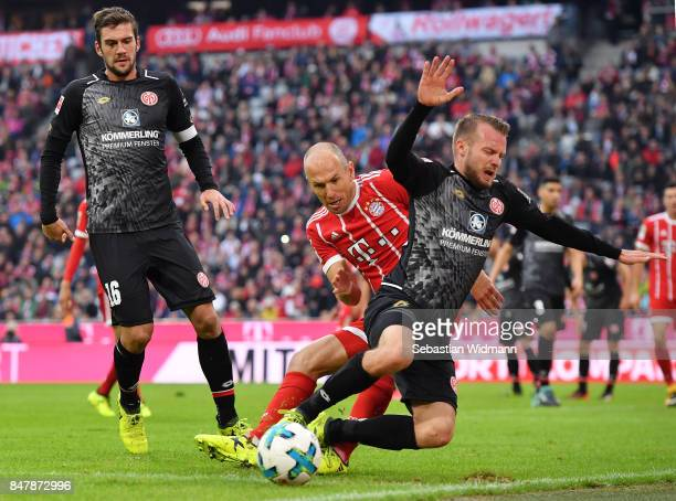 Arjen Robben of Bayern Muenchen fights for the ball with Daniel Brosinski of Mainz during the Bundesliga match between FC Bayern Muenchen and 1 FSV...
