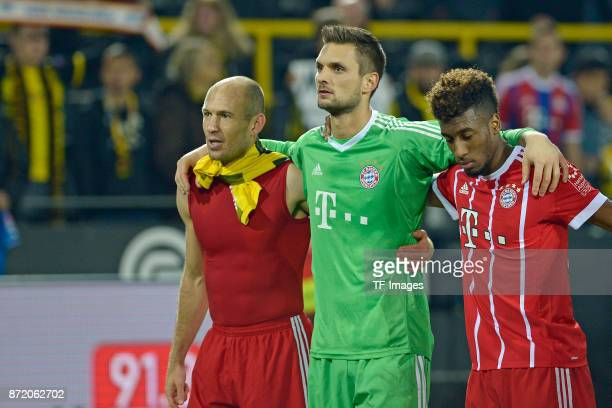 Arjen Robben of Bayern Muenchen Goalkeeper Sven Ulreich of Bayern Muenchen and Kingsley Coman of Bayern Muenchen celebrate after winning during the...