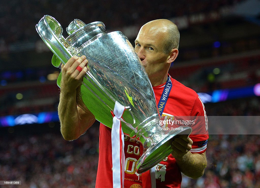 <a gi-track='captionPersonalityLinkClicked' href=/galleries/search?phrase=Arjen+Robben&family=editorial&specificpeople=194740 ng-click='$event.stopPropagation()'>Arjen Robben</a> of Bayern Muenchen holds the trophy after winning the UEFA Champions League final match against Borussia Dortmund at Wembley Stadium on May 25, 2013 in London, United Kingdom.