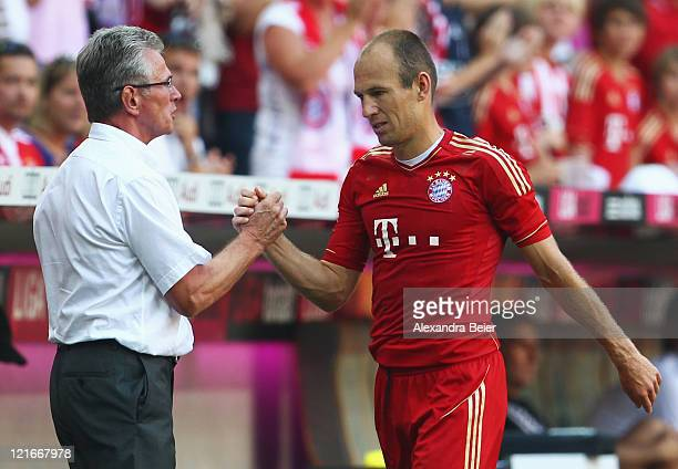 Arjen Robben of Bayern Muenchen is exchanged by team coach Jupp Heynckes during the Bundesliga match between FC Bayern Muenchen and Hamburger SV at...