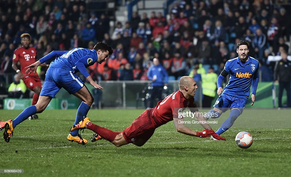 Arjen Robben of Bayern Muenchen is fouled by Jan Simunek of VfL Bochum resulting in a penalty during the DFB Cup quarter final match between VfL Bochum and Bayern Muenchen at Rewirpower Stadium on February 10, 2016 in Bochum, Germany.