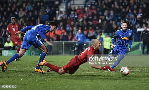 Arjen Robben of Bayern Muenchen is fouled by Jan Simunek of VfL Bochum resulting in a penalty during the DFB Cup quarter final match between VfL...